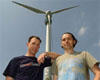 Mark Brigham and Dale Vince stand in front of Swaffham turbine