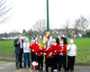 Pupils at Eyres Monsell Primary School stand next to their wind turbine