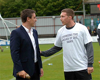 Gary Neville chats with former Manchester United colleague and now Forest green Rovers player Phil Marsh before kick-off